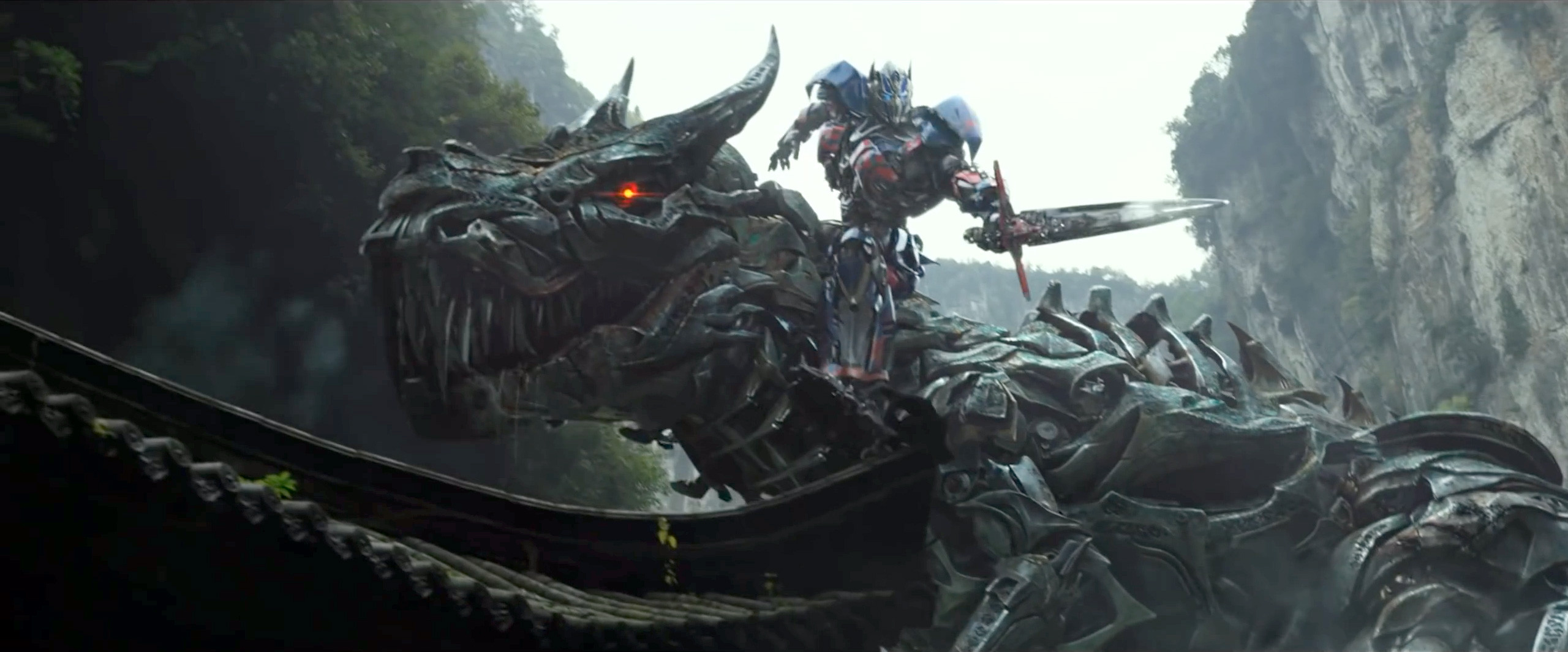 "Optimus Prime riding Grimlock in ""Transformers: Age of Extinction"""