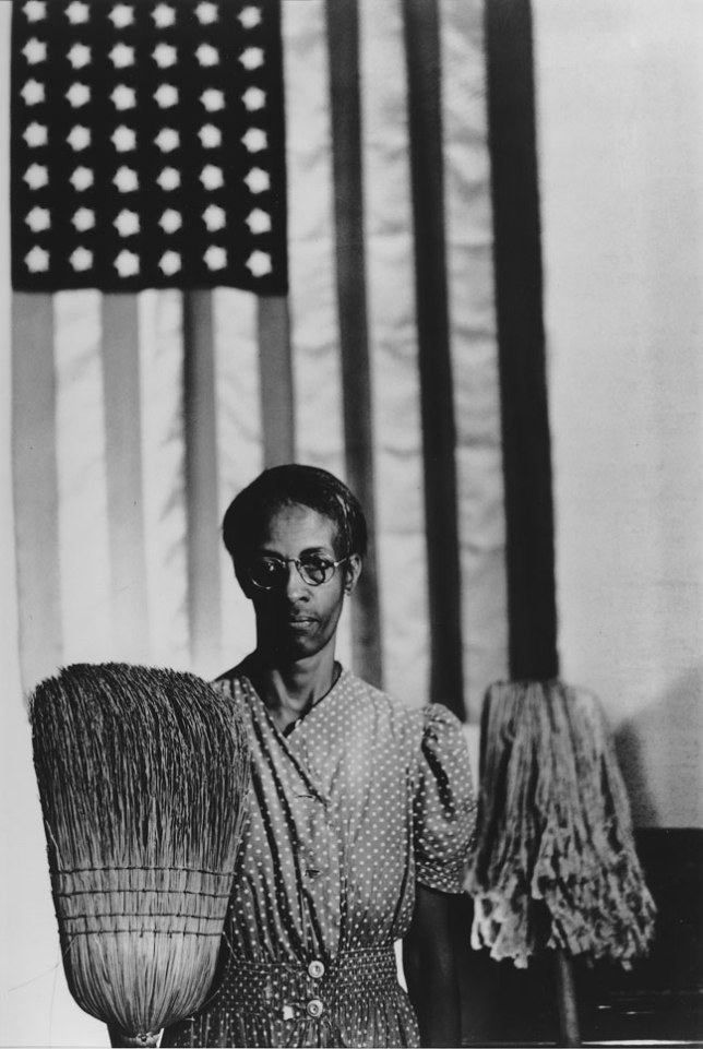 "Gordon Parks, ""American Gothic, Ella Watson, Washington, D.C., 1942."" © The Gordon Parks Foundation."