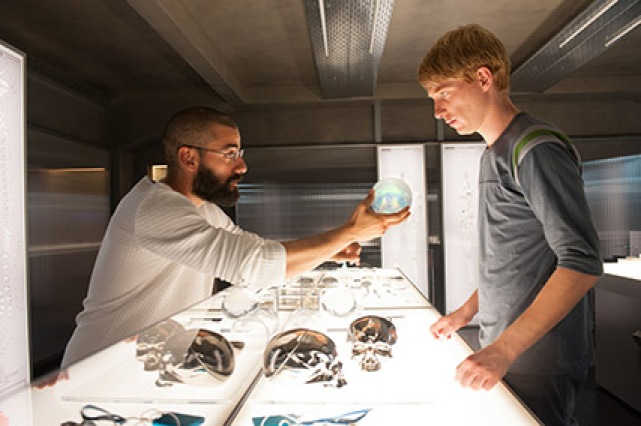 "Nathan Bateman (Oscar Isaac) and Caleb Smith (Domhnall Gleeson) in ""Ex Machina"""
