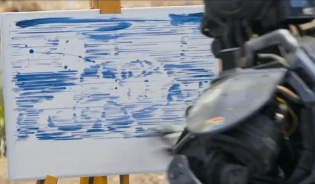 Chappie the robot shows his skills as a painter in Neil Blomkamp's film.