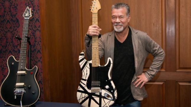 "Eddie Van Halen with a replica of his striped Stratocaster and EVH Brand ""Wolfgang"" guitar at ""What it means to be American""."