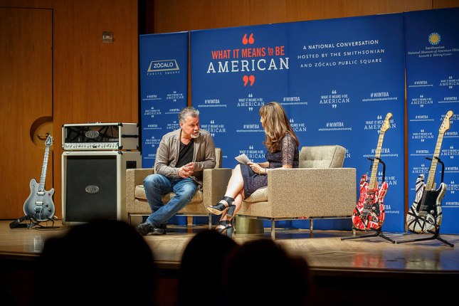 "Eddie Van Halen on stage at ""What it means to be American""."
