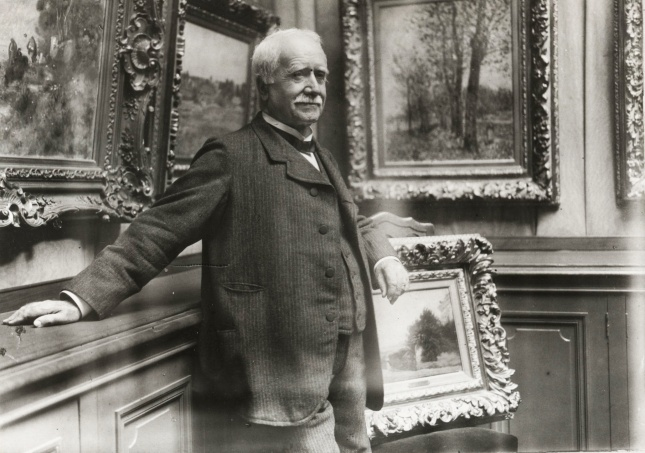Paul Durand-Ruel in his gallery in Paris, c1910.
