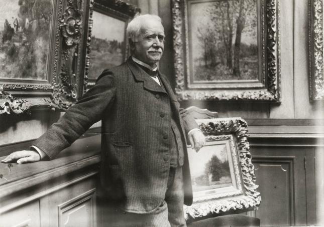 Paul Durand-Ruel in his gallery in Paris, c1910.