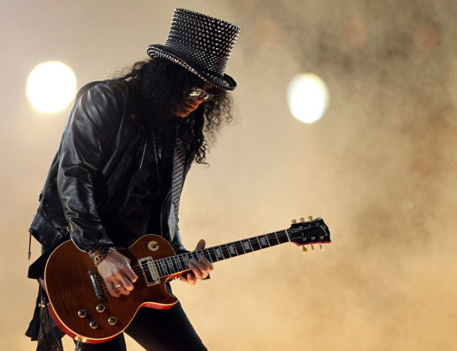 Slash performs at Super Bowl XLV Halftime Show at Cowboys Stadium on February 6, 2011 in Arlington, Texas. (Photo by Ronald Martinez/Getty Images)